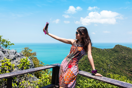 Love and Friends, Ready for your close up, woman taking picture of herself on balcony